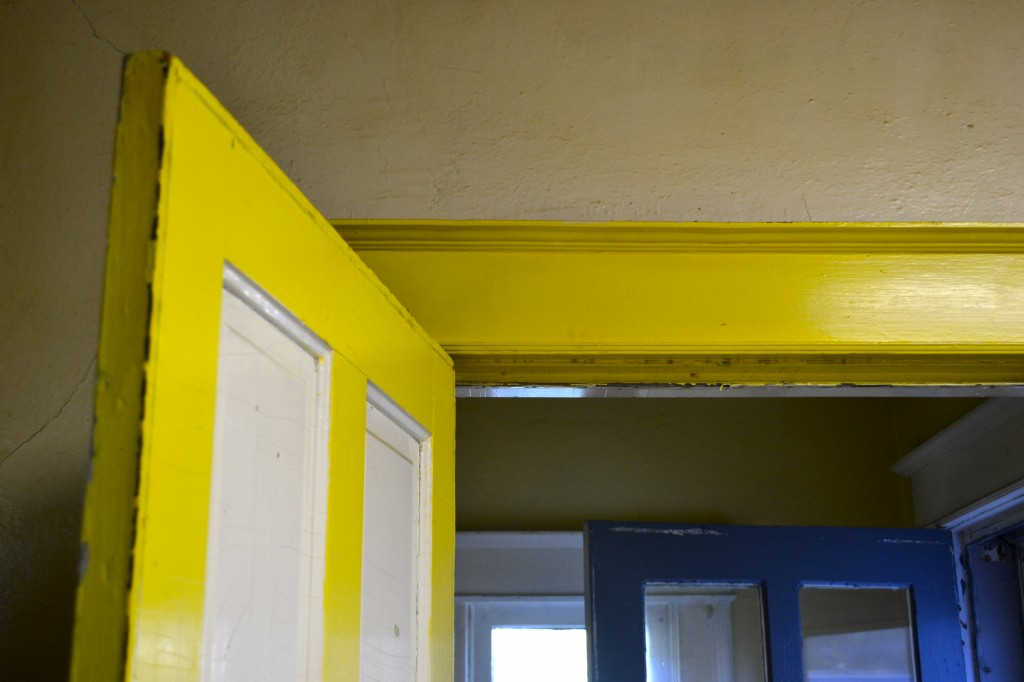 yellow and blue door frames and window frames