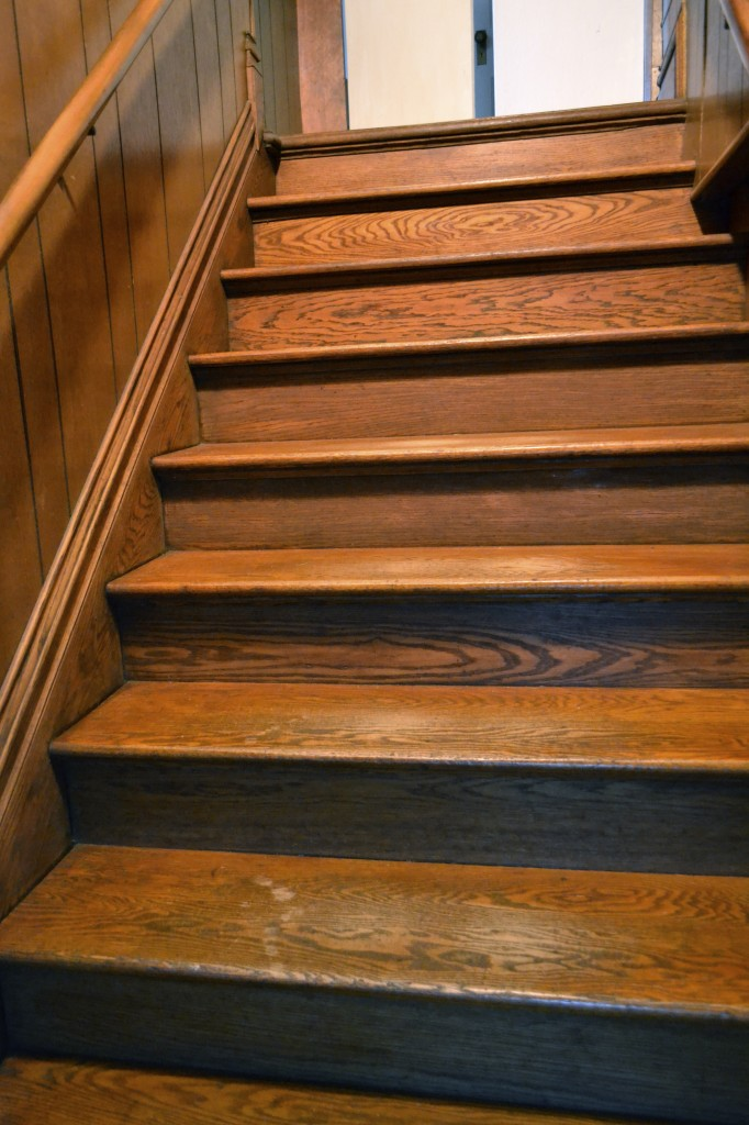wooden stairs with footsteps worn