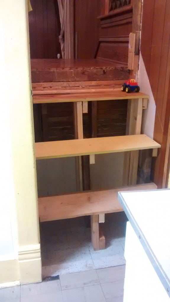 steps made from shelves and 2x4s